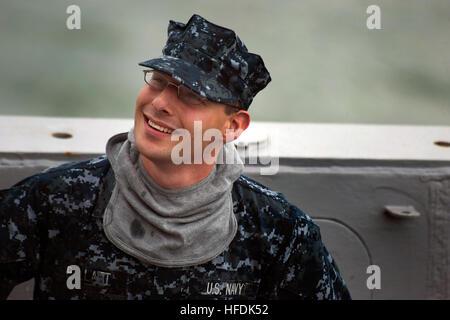 100731-N-LL432-034.USS NEW ORLEANS (LPD 18),  (July 31, 2010) .Information Technician Seaman Brandon Pellatt prepares - Stock Photo