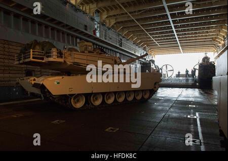 140403-N-BB269-395 SEA OF JAPAN (April 4, 2014) – A M1A1 Main Battle Tank maneuvers towards a landing craft air - Stock Photo