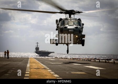 An MH-60S Seahawk, assigned to Helicopter Sea Combat Squadron 22 (HSC-22), takes off from the flight deck aboard - Stock Photo
