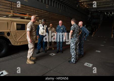Capt. Clinton A. Carroll, commander, Amphibious Squadron (COMPHIBRON) 3, Royal Australian Navy Commodore Peter Leavy, - Stock Photo