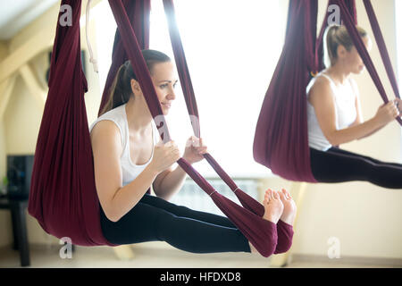 aerial exercises    bow yoga pose in hammock   stock photo bow yoga pose in hammock stock photo royalty free image      rh   alamy