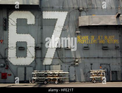 040709-N-4374S-025 Arabian Gulf (July 09, 2004) - Empty ordnance racks rest in front of the island aboard USS John - Stock Photo