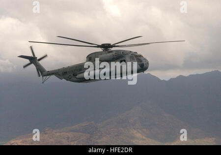 040719-N-8500S-013 PACIFIC OCEAN (July 19, 2004) -- A U.S. Marine Corps CH-53D Sea Stallion helicopter, assigned to the 'Ugly Angels' of Marine Heavy Helicopter Squadron, Three Six Two (HMH-362), conducts island familiarization flights in support of exercise Rim of the Pacific (RIMPAC) 2004.  RIMPAC is the largest international maritime exercise in the waters around the Hawaiian Islands. This year's exercise includes seven participating nations; Australia, Canada, Chile, Japan, South Korea, the United Kingdom and the United States. RIMPAC is intended to enhance the tactical proficiency of part Stock Photo