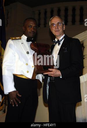 041015-N-4658M-108 Tumon, Guam (Oct. 15, 2004) Ð Commander, Naval Forces Marinas, Rear Adm. Arthur Johnson, presents - Stock Photo