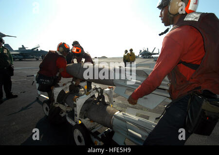 041108-N-8704K-002 Arabian Gulf (Nov. 8, 2004) - Aviation Ordnancemen, assigned to the ÒJolly RogersÓ of Fighter - Stock Photo