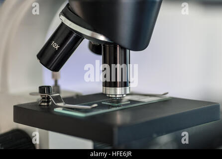 Microscope objective lens and slide close up - Stock Photo