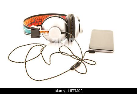 Headphones and smartphone Isolated on a white background - Stock Photo