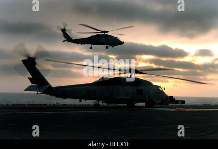 040324-N-6213R-225  Pacific Ocean (Mar. 24, 2004) - After an SH-60F Seahawk assigned to the 'Black Knights' of Helicopter - Stock Photo