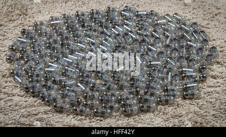 Dozens electron tubes made from thin glass - Stock Photo