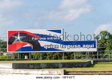 Revolutionary billboards in Che Guevara square. Behind it are groups of trees and the blue sky. - Stock Photo