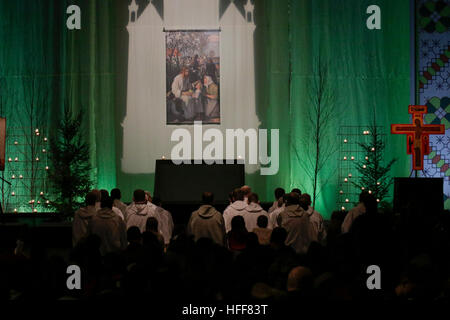 Latvia. 29th Dec, 2016. The brothers of Taize sit in front of the altar among the young pilgrims. The 2016 Pilgrimage - Stock Photo
