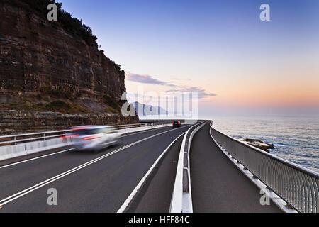 Sea Cliff bridge of Grand Pacific Drive along the NSW coast of Australia on Pacific at sunset. Scenic tourist drive - Stock Photo