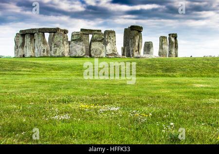 Lush green fields by prehistoric Stonehenge in Salisbury, England - Stock Photo