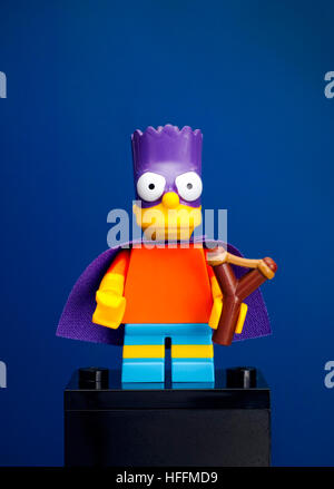 Tambov, Russian Federation - June 08, 2015 Lego Bart Simpson minifigure as a Bartman with slingshot on blue background. - Stock Photo