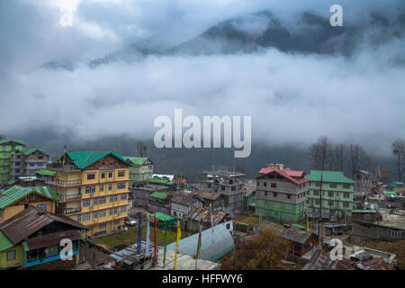 Himalayan mountain village town of Lachen, Sikkim on a foggy winter morning. - Stock Photo
