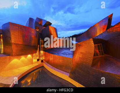 Guggenheim Museum at night, Bilbao, Biscay, Basque Country, Spain - Stock Photo