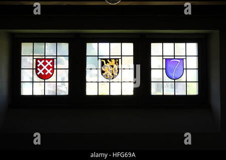 Three stained glass crests in a window of the Kirchgemeinde Oberdiessbach (Oberdiessbach Parish Church) in Oberdiessbach, - Stock Photo