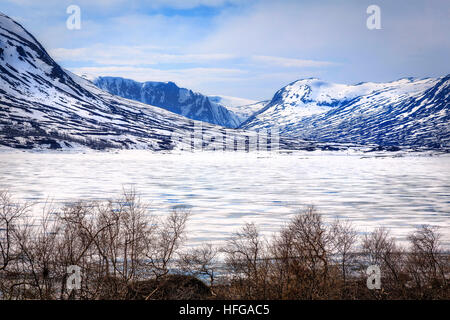 The ice breaking up on the lake in Fjordane, Norway in Spring - Stock Photo