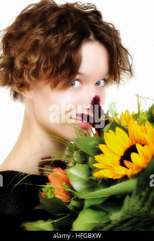 Girl holding flower bouquet - Stock Photo