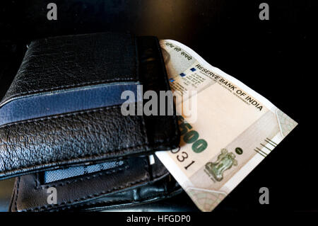 Black leather wallet with new indian currency - Stock Photo