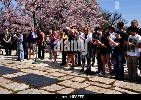 Arlington, Virginia - April 12, 2014: Tourists snapping photos at the gravesites of President John F. Kennedy, Jacqueline - Stock Photo