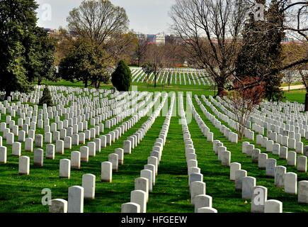Arlington, Virginia - April 12, 2014:  Row upon row of military gravesites on a hilly slope at Arlington National - Stock Photo