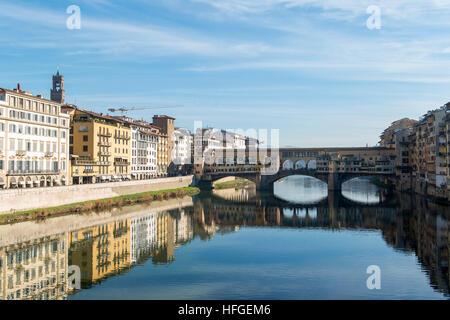 Ponte Vecchio bridge on the Arno river in Florence, Italy - Stock Photo