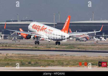 Easyjet Airbus A320 landing at El Prat Airport in Barcelona, Spain. - Stock Photo