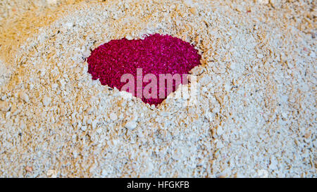 One Red Heart in the sand on the white sand of coral with empty space - Stock Photo