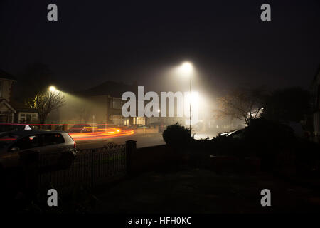 Wimbledon, London, UK. 30th December 2016. Mist and fog all day in SW London with thick fog forming as night falls. - Stock Photo
