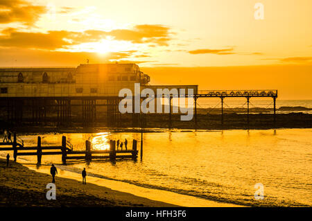 Aberystwyth Wales UK,  New Years Eve, Saturday 31  December 2016  UK weather: Sunset over the seaside pier  in Aberystwyth - Stock Photo