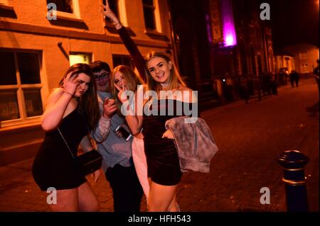 Aberystwyth Wales UK, Saturday 31 Dec 2016 / Sunday 01 Jan 2017  Groups of happy young people out partying on the - Stock Photo