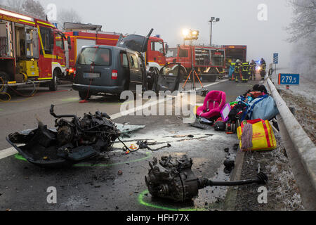 Rheinboellen, Germany. 01st Jan, 2017. Rescue workers stand at the site of the accident where two people were killed - Stock Photo