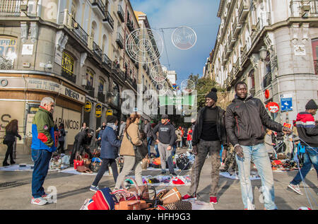 Madrid, Spain. 1st January 2017. First day of 2017 on the streets in Madrid, Spain. in the picture people in the - Stock Photo