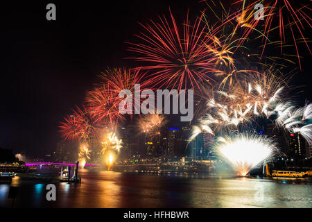 BRISBANE, AUSTRALIA, DEC 31 2016: New Year fireworks over night sky at Southbank, Brisbane, Australia - Stock Photo