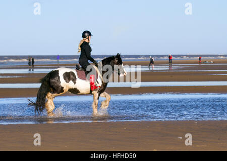Ainsdale, Merseyside, UK Weather.  2nd January, 2017. Bright, cold, and sunny in Southport as lady riders from Ormskirk - Stock Photo