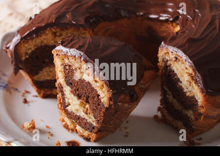 marble cake with chocolate chopped into pieces close-up on a plate. horizontal - Stock Photo
