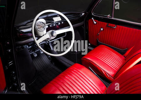 antique car with red interior inside and old black wheel stock photo 51990727 alamy. Black Bedroom Furniture Sets. Home Design Ideas