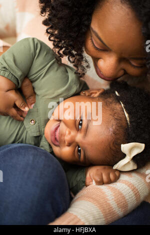 Happy African American mother and her daugher. - Stock Photo