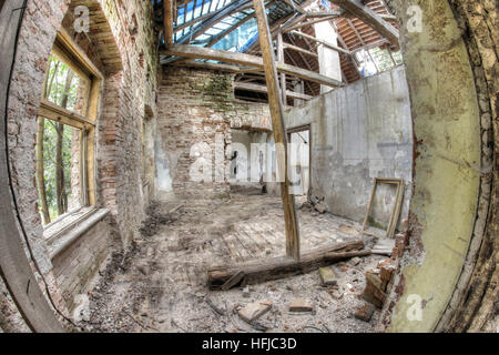 Ruins of the building in dilapidated condition - leaky roof - Stock Photo