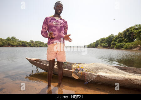 Baro village, Guinea, 1st May 2015: Fishermen prepare their nets. This time is normally good for fishing because - Stock Photo