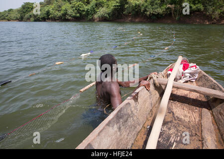 Baro village, Guinea, 1st May 2015: Fishermen move out into deeper water. This time is normally good for fishing - Stock Photo