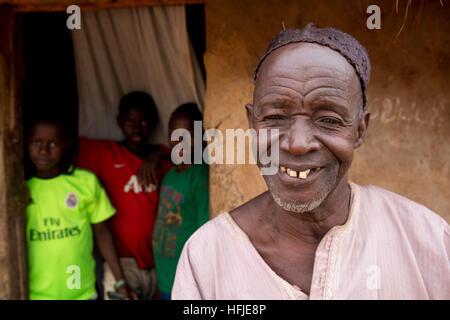 Gbderedou Baranama, Guinea, 2nd May 2015; Blacksmith Namory Camara, 80, 2 wives, 12 children, outside his house. - Stock Photo