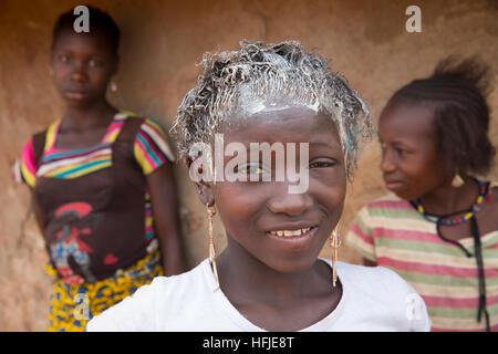 Gbderedou Baranama, Guinea, 2nd May 2015; Dalo, grand-daughter of blacksmith Namory Camara, 80. - Stock Photo