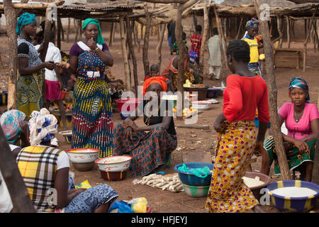 Koumban village, Guinea, 2nd May 2015; An informal early morning market on a non-market day. - Stock Photo