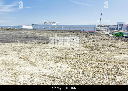 Landscape transform into urban area with machinery, people are working. Thermal insulation is on walls of the edifice - Stock Photo