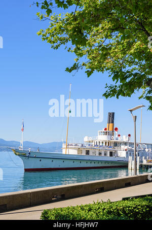 Framed view of the Belle Epoque paddle steamer La Suisse moored in Ouchy, Lausanne, Vaud, Switzerland - Stock Photo
