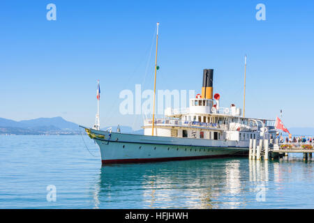 The Belle Epoque paddle steamer La Suisse moored in Ouchy with passengers boarding, Lausanne, Switzerland - Stock Photo