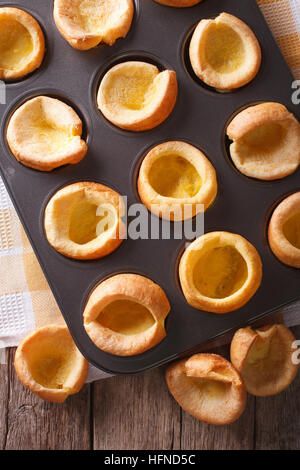 delicious Yorkshire puddings in baking dish closeup. vertical top view - Stock Photo