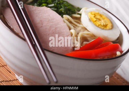 Japanese food: noodles ramen with pork and egg in a bowl macro. horizontal - Stock Photo